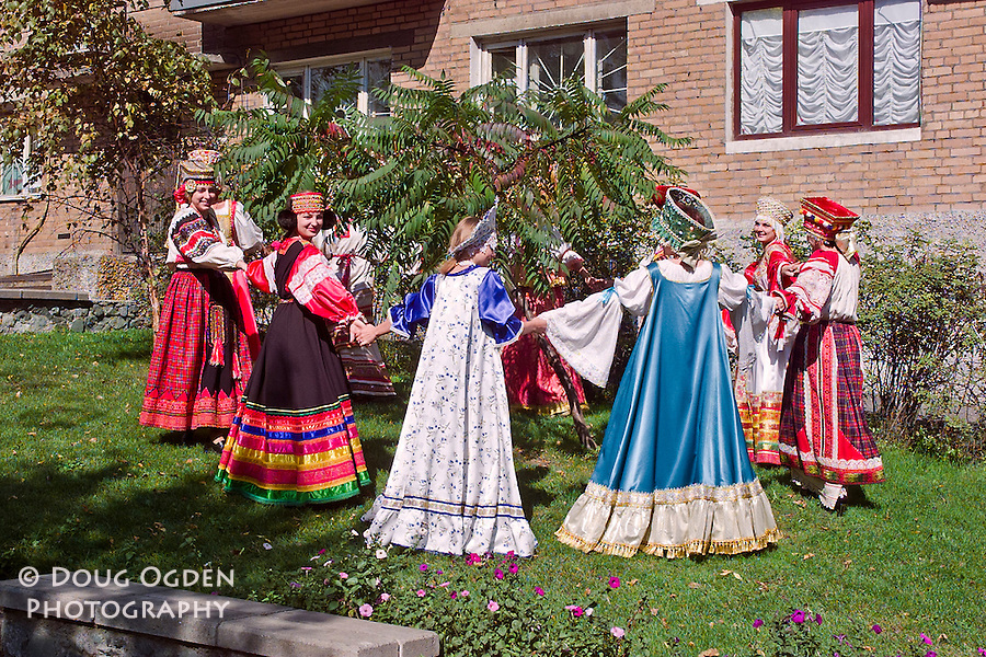Women dancing in beautiful traditional dresses and head pieces or crowns.  Each dress represents a different region of Russia, Vladivostok, Russia,