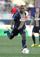 CHESTER, PA - AUGUST 12, 2012:  Amobi Okugo (14) of the Philadelphia Union playing against the Chicago Fire during an MLS match at PPL Park, in Chester, PA on August 12. Fire won 3-1.