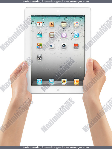 Young woman holding Apple iPad 2 tablet computer in her hands. Isolated on white background.