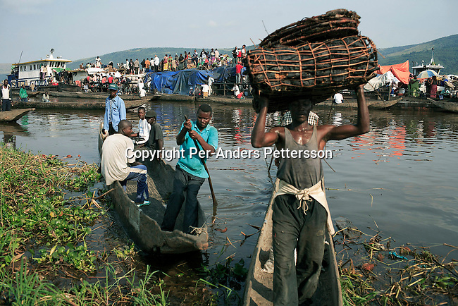 MALUKU, DEMOCRATIC REPUBLIC OF CONGO APRIL 26: Unidentified people disembark a boat on April 26, 2006 in the port in Maluku, Congo, DRC. About five hundred people traveled for seven weeks on the Congo River. A distance of about1750 kilometers from Kisangani to Kinshasa. The port is a small port about 50 kilometers from the capital Kinshasa. Many villagers come here to trade goods. The Congo River is a lifeline for millions of people, who depend on it for transport and trade. Congo is planning to hold general elections by July 2006, the first democratic elections in forty years. (Photo by Per-Anders Pettersson....