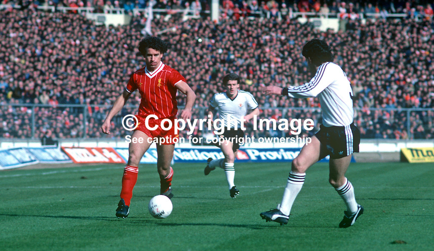 Craig Johnston, Liverpool and England, taken during 1983 Milk Cup Final against Manchester United at Wembley, London, UK. Liverpool won 2-1. Also in photo right is Arthur Albiston, Manchester United. 19830326CJ2..Copyright Image from Victor Patterson, 54 Dorchester Park, Belfast, United Kingdom, UK...For my Terms and Conditions of Use go to http://www.victorpatterson.com/Victor_Patterson/Terms_%26_Conditions.html