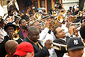 Hundreds of musicians and mourners followed the jazz funeral for Dinerral Shavers, 25, who died from a gunshot to the back of his head in New Orleans, Sat., Jan. 6, 2007. Shavers was the snare drummer for the Hot 8 Brass Band and the music teacher at L.E. Rabouin High School, where he had recently begun the school's first-ever marching band. He was killed by a teen who was trying to shoot his stepson. ..(AP Photo/Cheryl Gerber).