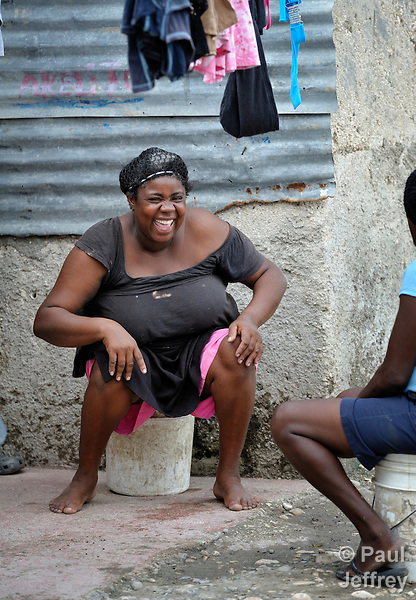 A woman laughs in Batey Bombita, a community in the southwest of the Dominican Republic whose population is composed of Haitian immigrants and their descendents.