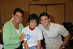 Adam Gregory with child who received a new hearing aid at the Starkey Hearing Foundation event on June 18, 2011 at the Las Vegas Hilton, Las Vegas, Nevada. (Photo by Sue Coflin/Max Photos)