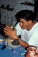 Artisan working on a silver vase at the El Castillo silver workshop in Taxco Viejo, Guerrero, Mexico