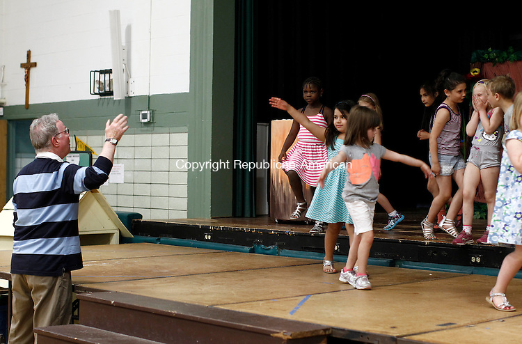 Waterbury, CT- 02 June 2014-060214CM07- Pat Hearn, co-director of Children's Theater at Blessed Sacrament runs through rehearsal of Peter Pan at the school in Waterbury on Monday.  Christopher Massa Republican-American