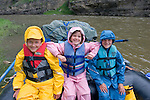 Sophie, Theo, and Charles Marshall- Triplets age 8 on Smith River in Montana.