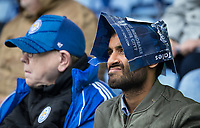 Leicester City supporters shield themselves from the rain during the Premier League match between Leicester City and Newcastle United at the King Power Stadium, Leicester, England on 29 September 2019. Photo by Andy Rowland.
