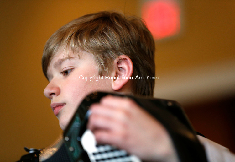 Waterbury, CT- 31 May 2015-053115CM10-  Cody McSherry of Lancaster PA, plays the accordion with the Junior Festival Orchestra during the gathering of the Connecticut Accordion Association at Vasi's Restaurant in Waterbury on Sunday.  The Young Musicians in Concert played a combination of classical jazz ensembles, as well as solo performances.  Christopher Massa Republican-American