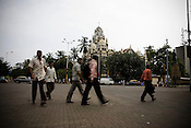 Office-goers are seen rushing for work in the early hours of a business day in the financial capital of India, Mumbai.
