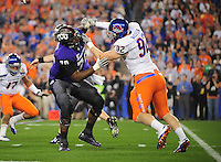 Jan. 4, 2010; Glendale, AZ, USA; Boise State Broncos defensive lineman (92) Shea McClellin battles TCU Horned Frogs offensive tackle (70) Marshall Newhouse in the 2010 Fiesta Bowl at University of Phoenix Stadium. Boise State defeated TCU 17-10. Mandatory Credit: Mark J. Rebilas-