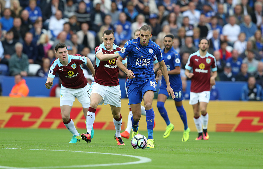 Leicester City's Islam Slimani and Burnley's Dean Marney<br /> <br /> Photographer Stephen White/CameraSport<br /> <br /> The Premier League - Leicester City v Burnley - Saturday 17th September 2016 - King Power Stadium - Leicester <br /> <br /> World Copyright &copy; 2016 CameraSport. All rights reserved. 43 Linden Ave. Countesthorpe. Leicester. England. LE8 5PG - Tel: +44 (0) 116 277 4147 - admin@camerasport.com - www.camerasport.com
