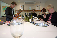 Mas La Chevaliere. near Beziers. Languedoc. Tasting wine. France. Europe. Wine glass. In the professional tasting room.