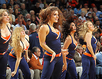 Virginia dancers perform during an NCAA basketball game Monday Jan. 20, 2014 in Charlottesville, VA. Virginia defeated North Carolina 76-61.