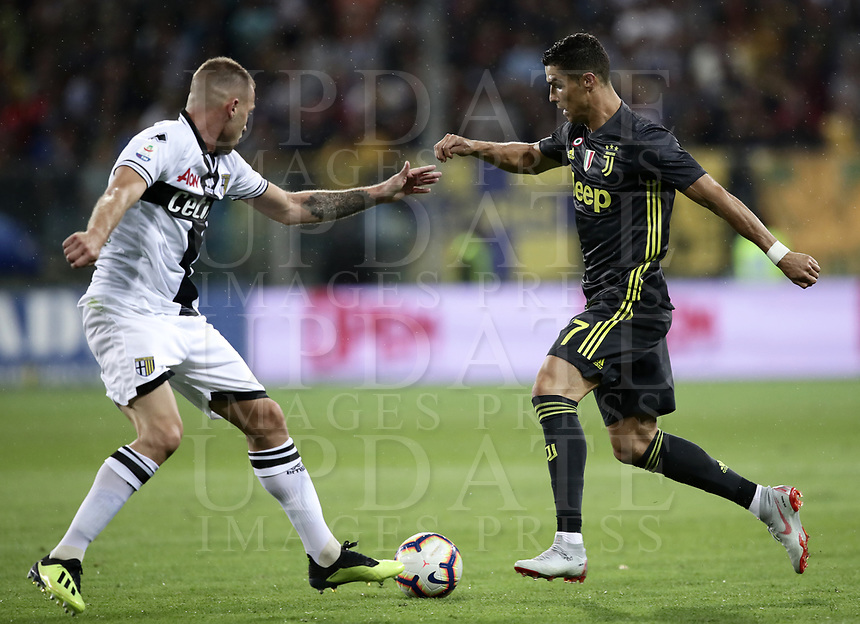 Calcio, Serie A: Parma - Juventus, Parma stadio Ennio Tardini, 1 settembre 2018.<br /> Juventus' Cristiano Ronaldo (r) in action with Parma's Simone Iacoponi (l) during the Italian Serie A football match between Parma and Juventus at Parma's Ennio Tardini stadium, September 1, 2018. <br /> UPDATE IMAGES PRESS/Isabella Bonotto