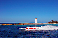 Speed boat passing the lighthouse marking the end of Nassau Harbour on the island of New Providence in the Bahamas