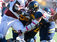 October 20th, 2012: California's Michael Lowe tackles Stanford's Stepfan Taylor during a game at Memorial Stadium at Berkeley, Ca   Stanford defeated California 21 - 3