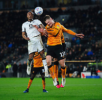 Swansea City's Andre Ayew vies for possession with Hull City's Sean McLoughlin<br /> <br /> Photographer Chris Vaughan/CameraSport<br /> <br /> The EFL Sky Bet Championship - Hull City v Swansea City -  Friday 14th February 2020 - KCOM Stadium - Hull<br /> <br /> World Copyright © 2020 CameraSport. All rights reserved. 43 Linden Ave. Countesthorpe. Leicester. England. LE8 5PG - Tel: +44 (0) 116 277 4147 - admin@camerasport.com - www.camerasport.com