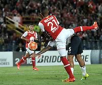 BOGOTA- COLOMBIA - 16-02-2016: William Tesillo (Der.) jugador del Independiente Santa Fe de Colombia, disputa el balon con Leonardo Caceres (Izq.) jugador de Cerro Porteño del Paraguay, durante partido entre Independiente Santa Fe de Colombia y Cerro Porteño del Paraguay por la segunda fase de la Copa Bridgestone Libertadores en el estadio Nemesio Camacho El Campin, de la ciudad de Bogota. / William Tesillo (R) player of Independiente Santa Fe of Colombia, figths for the ball with Leonardo Caceres (L) player of Cerro Porteño of Paraguay during a match between Independiente Santa Fe of Colombia and Cerro Porteño of Paraguay for the second phase, of the Copa Bridgestone Libertadores in the Nemesio Camacho El Campin in Bogota city. VizzorImage / Luis Ramirez / Staff.