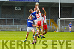 High fielding action from Templenoe against An Ghaeltacht in the Intermediate Club football championship final on Sunday