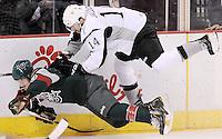 San Antonio Rampage's Jean-Francois Jacques (14) hits Houston Aeros' Jarod Palmer during the third period of an AHL hockey game, Sunday, Oct. 14, 2012, in San Antonio. San Antonio won 3-2. (Darren Abate/pressphotointl.com)