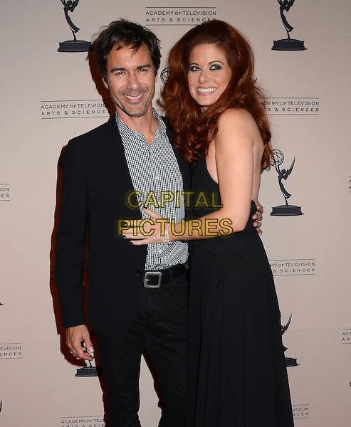 Eric McCormack, Debra Messing<br /> The Television Academy presents An Evening Honoring James Burrows at The Academy of Television Arts &amp; Sciences in North Hollywood, California, USA.<br /> October 7th, 2013<br /> half length dress suit check shirt side black sleeveless  <br /> CAP/ADM/BT<br /> &copy;Birdie Thompson/AdMedia/Capital Pictures