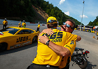Jun 17, 2018; Bristol, TN, USA; NHRA pro stock driver Jeg Coughlin Jr (left) celebrates with brother Troy Coughlin after winning the Thunder Valley Nationals at Bristol Dragway. Mandatory Credit: Mark J. Rebilas-USA TODAY Sports