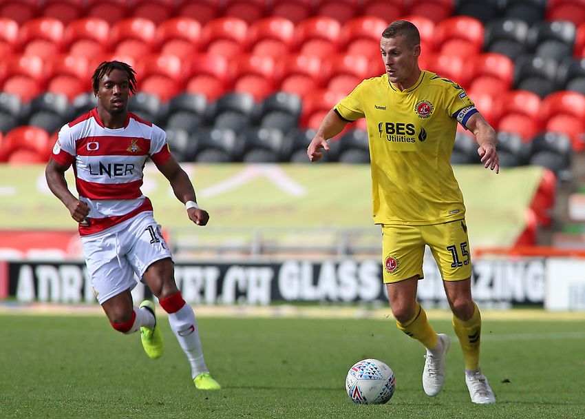 Fleetwood Town's Paul Coutts gets away from Doncaster Rovers' Kazaiah Sterling<br /> <br /> Photographer David Shipman/CameraSport<br /> <br /> The EFL Sky Bet League One - Doncaster Rovers v Fleetwood Town - Saturday 17th August 2019  - Keepmoat Stadium - Doncaster<br /> <br /> World Copyright © 2019 CameraSport. All rights reserved. 43 Linden Ave. Countesthorpe. Leicester. England. LE8 5PG - Tel: +44 (0) 116 277 4147 - admin@camerasport.com - www.camerasport.com