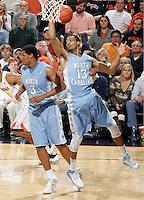 North Carolina forward J.P. Tokoto (13) grabs a rebound during an NCAA basketball game against Virginia Monday Jan. 20, 2014 in Charlottesville, VA. Virginia defeated North Carolina 76-61.