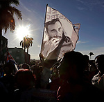Cubans gather along the road as they wait for the caravan carrying the ashes of Cuban leader Fidel Castro on the way to to Santa Ifigenia cemetery, Castro's final resting place, in Santiago de Cuba on Sunday, December 4, 2016
