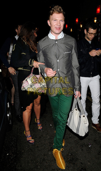 "HENRY CONWAY.""A Bathing Ape'  store relaunch party,.24 Kingly Street, London, England 18th July 2009.full length grey gray top jacket green trousers bag purse white brown shoes.CAP/CAN.©Can Nguyen/Capital Pictures"