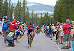 August 11, 2017 - Breckenridge, Colorado, U.S. -   Team Rally rider, Sara Poidevin, wearing the Queen of the Mountain Jersey pedals into huge crowds atop the difficult Moonstone climb during the second stage of the inaugural Colorado Classic cycling race, Breckenridge, Colorado.  Sara Poidevin wins the Women's Colorado Classic.