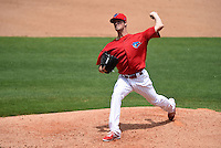 Philadelphia Phillies pitcher Cole Hamels delivers a pitch while on rehab assignment with the Clearwater Threshers during a game against the Dunedin Blue Jays on April 6, 2014 at Bright House Field in Clearwater, Florida.  Hamels went a scheduled four innings allowing three hits and striking out four taking the loss as Dunedin defeated Clearwater by the score of 5-2.  (Mike Janes/Four Seam Images)