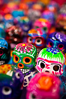 Colorful painted skulls (Calaveras) are sold on the market during the Day of the Dead festivities in Mexico City, Mexico, 28 October 2016. Skulls, skeletons and the other death symbols are used to adorn graves, altars and offerings during the Day of the Dead (Día de Muertos). A syncretic religious holiday, combining the death veneration rituals of the ancient Aztec culture with the Catholic practice, is celebrated throughout all Mexico. Based on the belief that the souls of the departed may come back to this world on that day, people gather at the gravesites in cemeteries, praying, drinking and playing music, to joyfully remember friends or family members who have died and to support their souls on the spiritual journey.