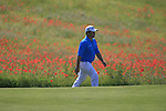 George Coetzee (RSA) walks by a field of wild poppies adjacent to the 12th hole during Day 2 of the Open de Espana at Real Club De Golf El Prat, Terrasa, Barcelona, 6th May 2011. (Photo Eoin Clarke/Golffile 2011)