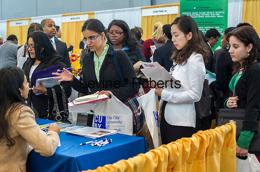 Job seekers attend the CUNY Big Apple Job and Internship Fair at the Jacob Javits Convention Center in New York on Friday, April 26, 2013.  The US Labor Department reports new claims for unemployment benefits for last week decreased to a seasonably adjusted 339,000. ( © Frances M. Roberts)