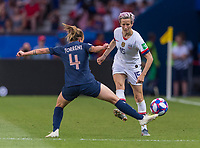 PARIS,  - JUNE 28: Marion Torrent #4 defends Megan Rapinoe #15 during a game between France and USWNT at Parc des Princes on June 28, 2019 in Paris, France.