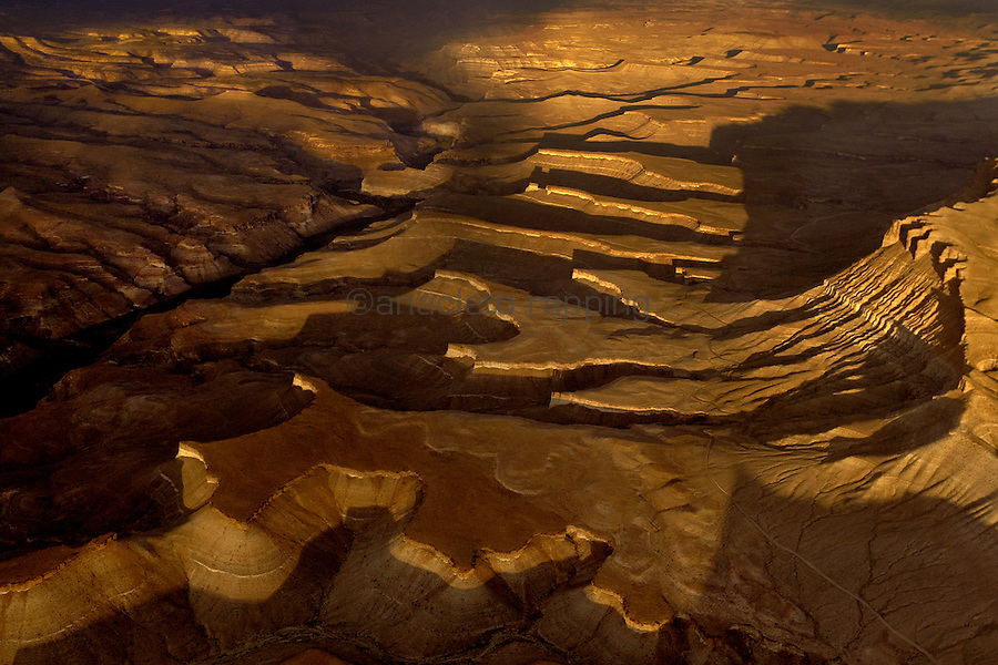 Sunset aerial view of  the Book Cliffs in Utah's Upper Desolation Canyon Wilderness. The cliffs overlook the historic Nine Mile Canyon.