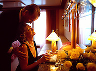 An older couple gets ready for a night out on the cruise ship they are staying on