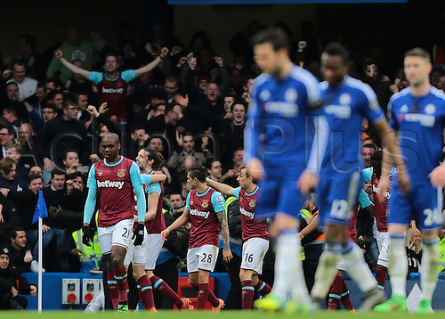 19.03.2016. Stamford Bridge, London, England. Barclays Premier League. Chelsea versus West Ham. West Ham United Striker Andy Carroll makes it 2-1 West Ham and celebrates with his team mates