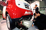 People look at Mitsubishi Motor's MiEV electric vehicle in Chiba, Japan.