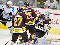Chicago Wolves goaltender Eddie Lack, right, looks into the net as the puck slides through for a goal by San Antonio Rampage's Scott Timmins, left, during the third period of an AHL hockey game, Wednesday, April 4, 2012, in San Antonio. San Antonio won 2-1. (Darren Abate/pressphotointl.com)