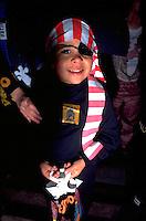 Boy age 6 trick or treating in pirate costume on Halloween night.  St Paul  Minnesota USA