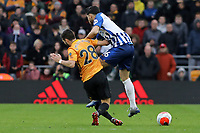 João Moutinho of Wolverhampton Wanderers tackles Alireza Jahanbakhsh of Brighton & Hove Albion during Wolverhampton Wanderers vs Brighton & Hove Albion, Premier League Football at Molineux on 7th March 2020