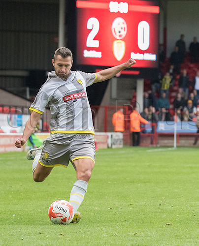 10.10.2015. Banks's Stadium, Walsall, England. Skybet League 1. Walsall versus Burton Albion. Burton Albion defender Phil Edwards  prepares to cross the ball in to the Walsall goal area in the last minutes of the game.