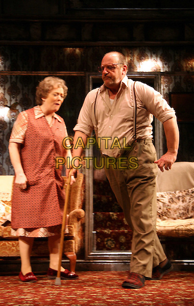 """ALISON STEADMAN & DAVID TROUGHTON.Star in """"Enjoy"""" at The Geilgud Theatre, London, England..January 30th, 2009.full length theatre stage play purple cane walking stick mouth open funny red dress pattern dress glasses costume red dress.CAP/DS.©Dudley Smith/Capital Pictures"""