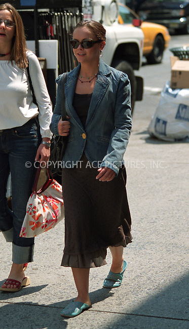 "Christina Ricci on the set of Woody Allen's film which has a project title ""Anything Else"" or ""Woody Allen's Summer 2002 Project"" in West Village in New York. June 19, 2002. Please byline: Alecsey Boldeskul/NY Photo Press.   ..*PAY-PER-USE*      ....NY Photo Press:  ..phone (646) 267-6913;   ..e-mail: info@nyphotopress.com"