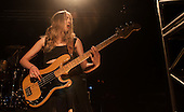 HAIM - bassist Este Haim - performing live on the first night of their UK Tour at the Rock City in Nottingham UK - 04 Mar 2014.  Photo credit: Tony Woolliscroft/IconicPix
