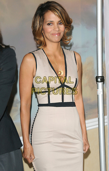 HALLE BERRY .at The Jenesse Silver Rose Gala & Auction held at The Beverly Hills Hotel in Beverly Hills, California, USA, .April 19th 2009                                                                     .half length grey gray beige dress black trim cleavage low cut gold necklace .CAP/DVS.©RockinExposures/Capital Pictures