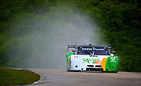 "The #61 BMW Riley of Mark Wilkins and Burt Frisselle kicks up a ""rooster tail"" in the rain during practice, Road America, Elkhart Lake, Wisconsin.  (Photo by Brian Cleary/www.bcpix.com)"